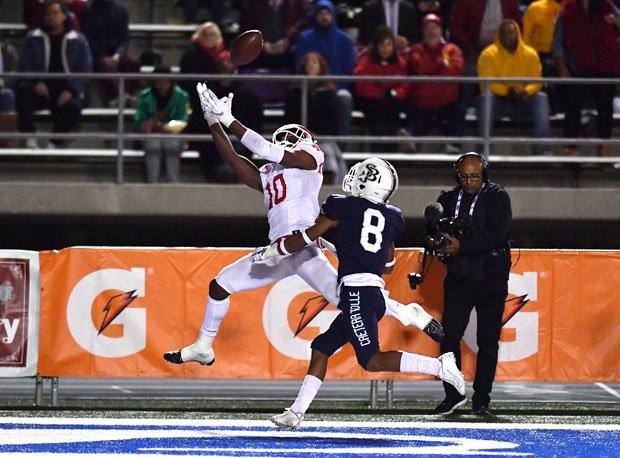 Kyron Ware-Hudson with one of his two touchdown grabs for Mater Dei.