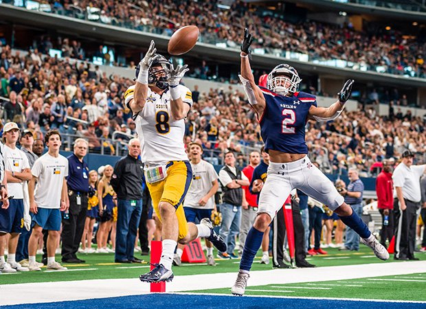Highland Park (Texas) receiver Bennett Brown scores a touchdown reception against Ryan in a UIL 5A Division 1 semifinal game at AT&T Stadium in Arlington.