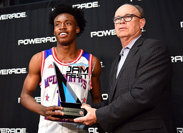 Sexton receives the trophy for winning the dunk contest.
