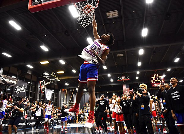 Collin Sexton of Pebblebrook (Ga.) finishes a dunk during the Jam Fest on Monday night in Chicago.