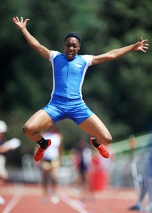 Robin Reynolds soars to her title in the long jump.