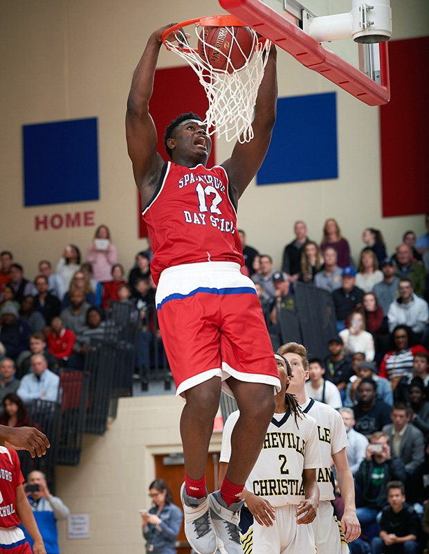 Zion Williamson finishes a two-handed dunk during Thursday night's game against visiting Asheville Christian Academy.