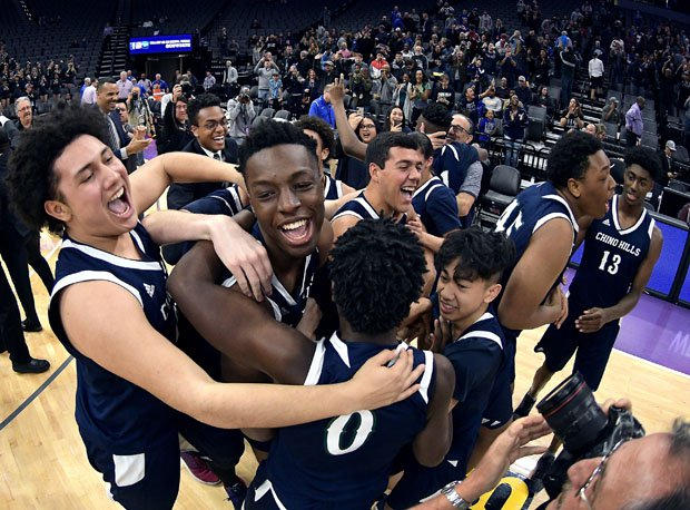 Onyeka Okongwu (middle of celebration) won three state titles — and a mythical national crown — in four years playing for Chino Hills (Calif.).