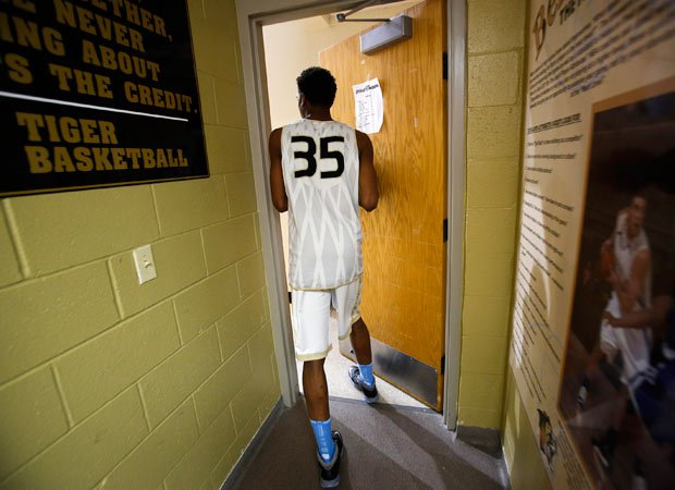 Malik exits the locker room while heading to the court for a recent practice.