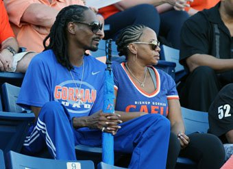 Snoop Dogg - Calvin Broadus - and his wife Shante Broadus watch their son Cordell warm up before Friday's game.