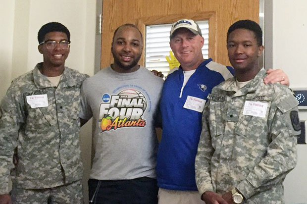 Imoter Mngerem and coach Kelly Davis are flanked by two of Mngerem's best friends and former football teammates, Moleik Campbell and Mahlik Faulk.