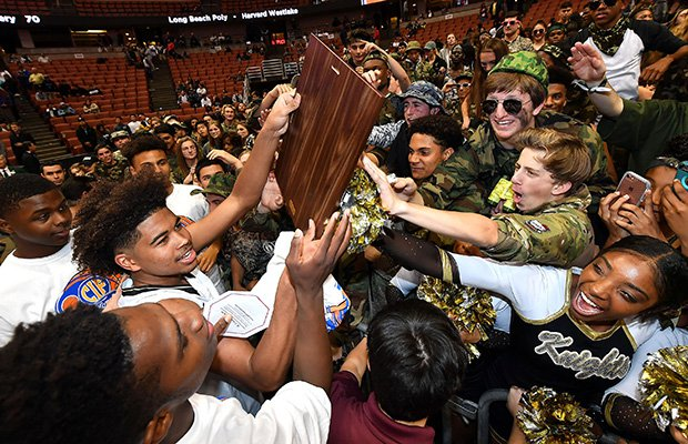 Ethan Thompson celebrates by sharing the championship plaque with Bishop Montgomery fans.