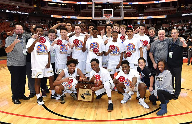 Bishop Montgomery poses for a team photo following their victory over Mater Dei in the Open Division championship game Saturday night at the Honda Center.
