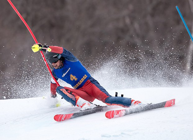 Aiden Markoff of Kearsarge Regional High School (N.H.) carves a hard turn while competing in the slalom on Mount Sunapee.