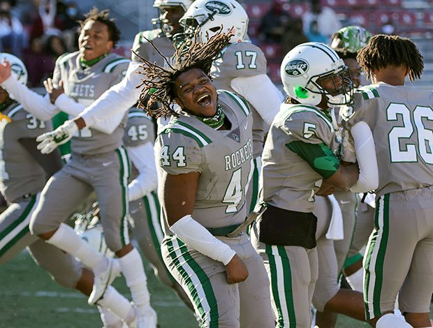 A Miami Central (Fla.) player celebrates with his teammates following their victory in the FHSAA 6A state championship game.