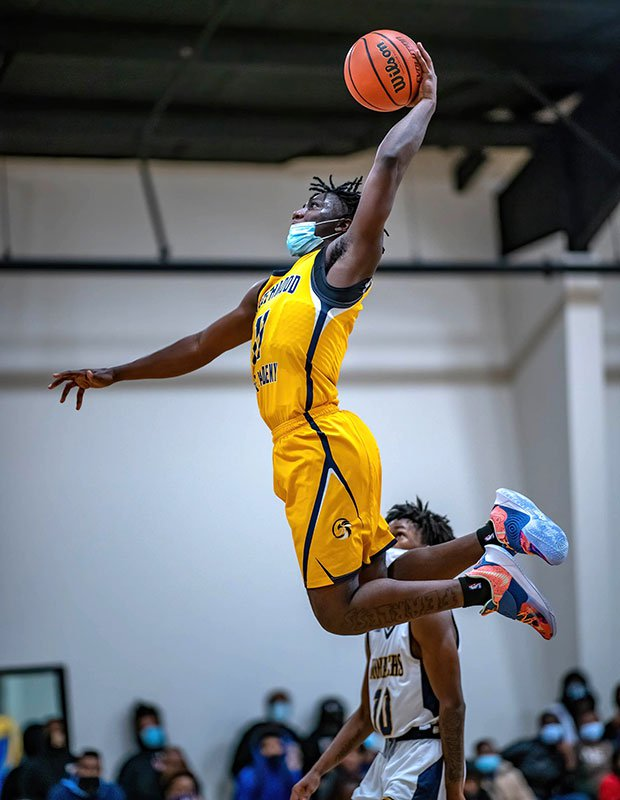 Guard JaQuantae Harris of Northwood Temple Academy (N.C.) soars for a dunk against host New Life Christian Academy.