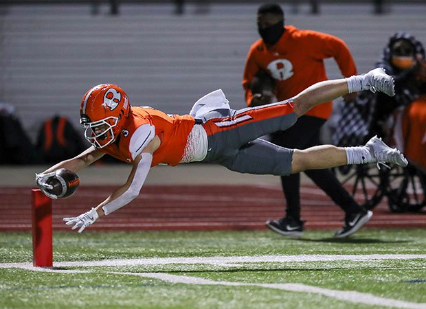 Receiver Jaxon Johnson of Rockwall (Texas) dives into the end zone for a touchdown during a UIL 6A Division 1 Bi-District playoff game.