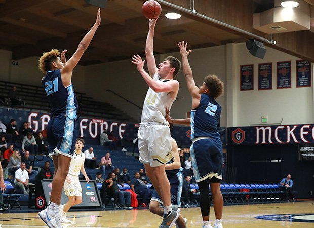 Forward Riley Battin scores two of his game-high 28 points for Oak Park.
