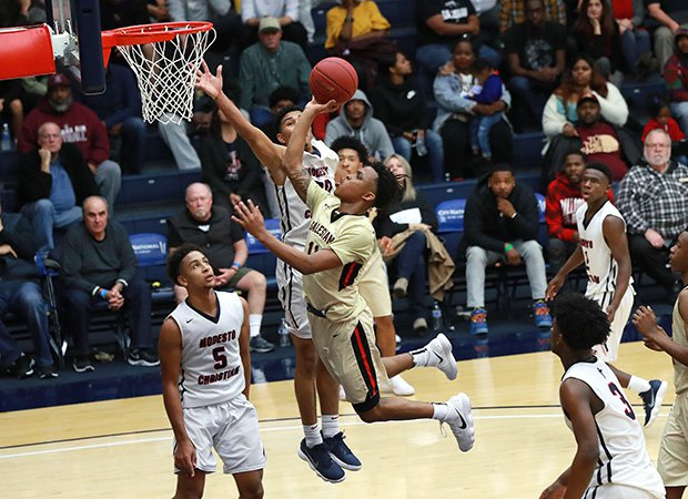 Salesian guard James Akinjo drives to the hoop for two of his game-high 35 points.