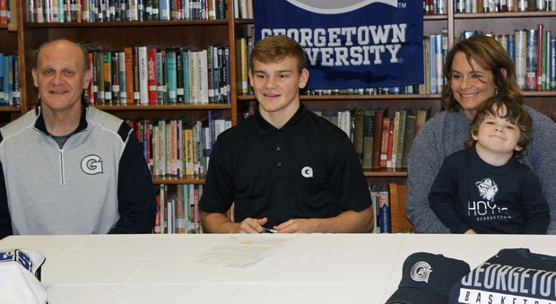 Mac McClung signing last month with Georgetown.