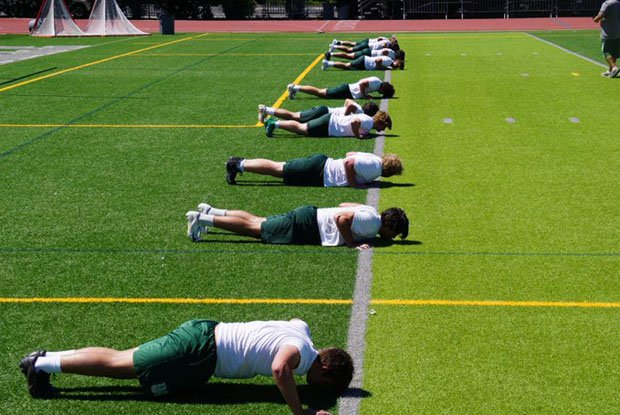 De La Salle players trained 11 at a time with a coach on Monday in first day of conditioning.