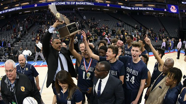 Coach Dennis Latimore and Huskies celebrate state Division 1 title.