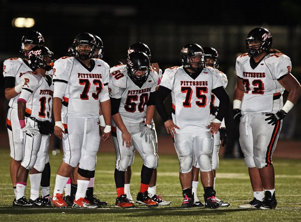 Pittsburg's stout defensive line waits for Freedom to break from the sideline. Pittsburg outgained Freedom 400-263.