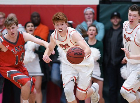 Junior Kenny Foster (center) is one of several key returnees for the Smoky Hill boys basketball team. The Buffaloes began the season ranked No. 2 in Class 5A.