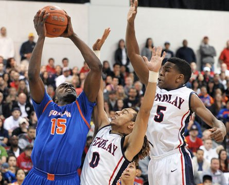 Findlay Prep's Nigel Williams-Goss and Dominic Artis defend the nation's No. 1 ranked senior, Shabazz Muhammad of Bishop Gorman. Muhammad entered the contest averaging over 30 points per game but was limited to 19 in Saturday's loss.