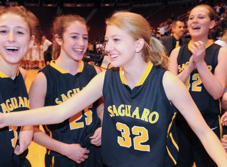 Kaitlyn Quinn (32) was in the middle of Saguaro's joyous celebration of its first state title.