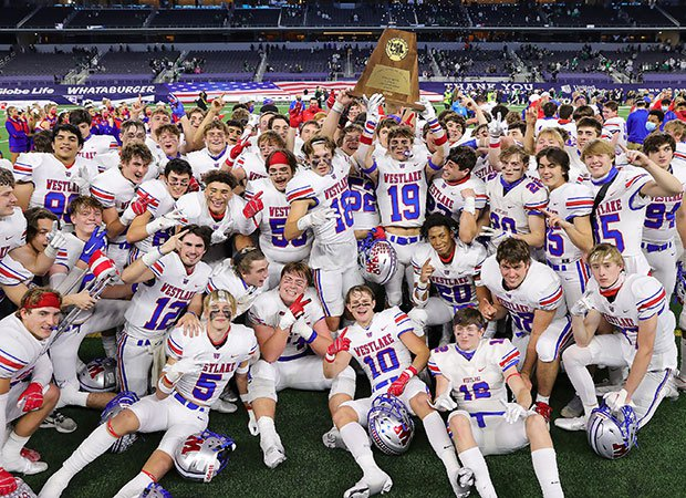 Westlake players celebrate winning their second consecutive state championship trophy.