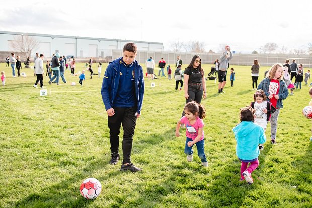 Bellini works with young kids, teaching them the game he loves. He and a number of his teammates went to a school that offers the Head Start program and taught kids ages 3 to 7 how to play soccer.