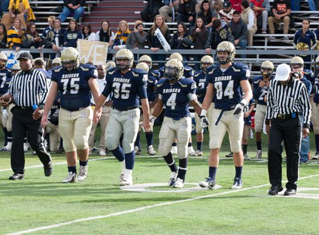 Spencer Stark (75), with head down, heads out for the opening coin toss in Saturday's game.