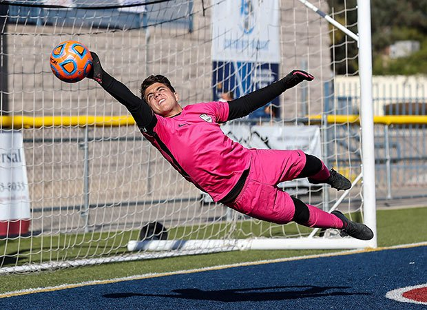 Walden Grove (Ariz.) goalkeeper Ethan Itule makes a diving save en route to a 3-0 victory over Prescott in an AIA 4A state semifinal game.