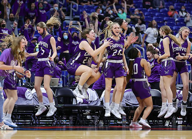 Canyon (Texas) players celebrate wildly as the final seconds countdown in their victory over Hardin-Jefferson in the UIL Class 4A state championship game at the Alamodome in San Antonio.