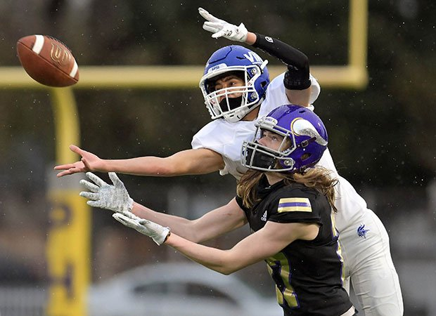 Curtis (Wash.) receiver Issac Emanuel (top) goes over the shoulder of Puyallup defensive back Jaden Kolowitz trying to make the reception.