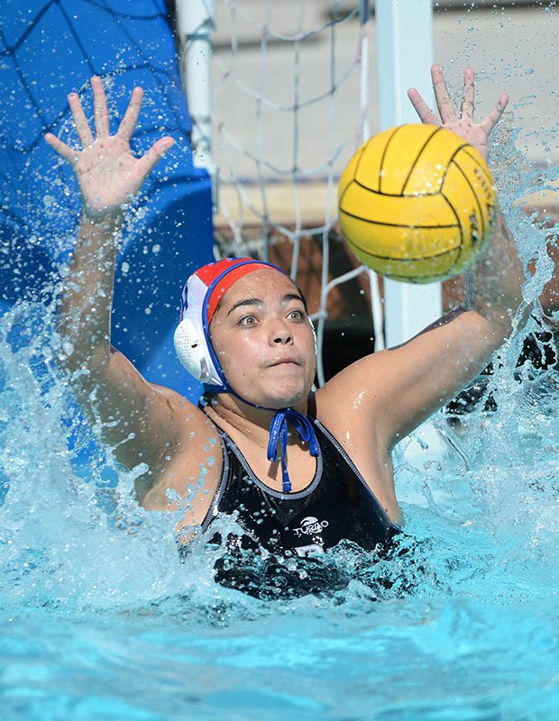 A Dana Hills (Calif.) goalie eyes an incoming shot during a game against host Aliso Niguel.