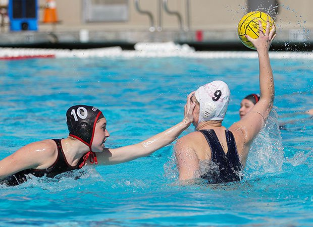 A Glendora (Calif.) defender covers the face of a St. Lucy's player looking to pass the ball.