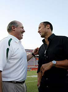 "Dwayne ""The Rock"" Johnson meets  with a fellow Hurricane alum."