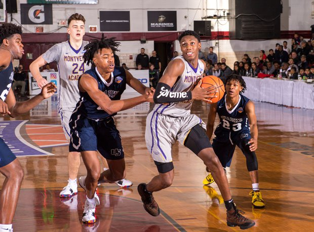 R.J. Barrett (5) scored 25 points and grabbed 15 rebounds to lead Montverde Academy to its fourth GEICO Nationals title.