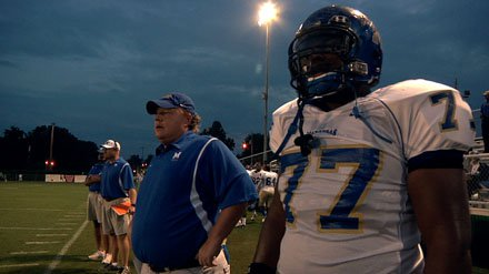 Coach Bill Courtney with lineman O.C. Brown.