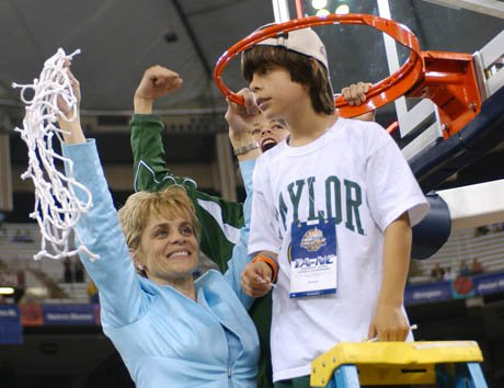 Kramer Robertson, then 10, stands on a ladder as his mom Kim Mulkey celebrates her first NCAA title as a head coach. Robertson, now 18 and a senior at Midway (Waco, Texas), and Mulkey have maintained a treasured and loving mother-son relationship.