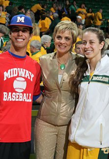 Baylor coach Kim Mulkey is flanked  by her son Kramer Robertson (left) and daughter Makenzie Robertson.