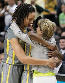 Kim Mulkey enjoys a post-game moment with Brittney Griner following Baylor's 2012 NCAA championship victory.