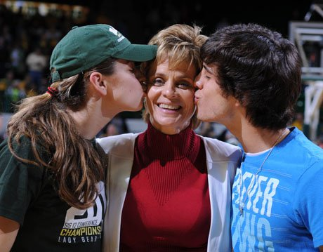 Baylor women's basketball coach Kim Mulkey enjoys a kiss from her son Kramer Robertson (right) and daughter Makenzie following another big victory.