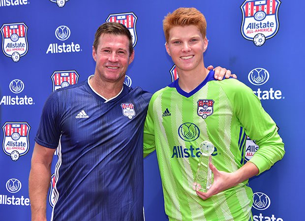 Brian McBride poses with Allstate Cup Man of the Match Jamis Fite.
