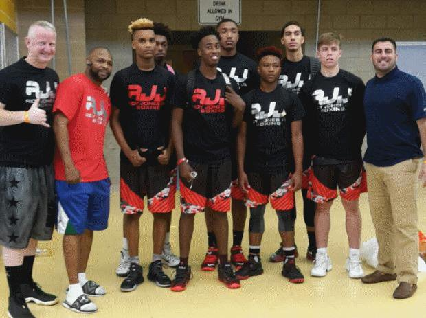 Roy Jones Jr. with his son's club team this summer.