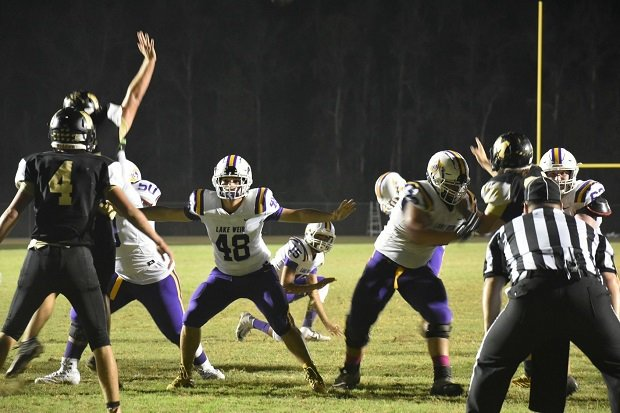 A rare bone disorder nearly ended Alec Green's football career, but the Lake Weir junior (48) fought back to play a big role in his team's success and first playoff win in school history.