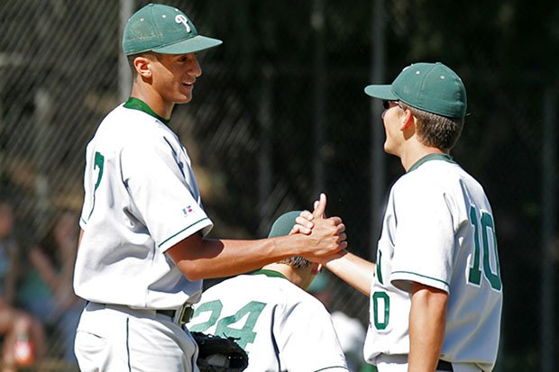 Colin Kaepernick celebrates with a  teammate during a 2006 high school baseball game.