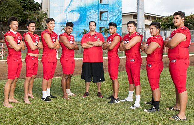 First-year head coach Makoa Freitas (center) is surrounded by several top returning players.