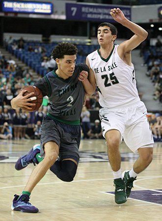 Chino Hills guard Lonzo Ball drives to the basket while closely guarded by De La Salle's Jordon Ratinho.