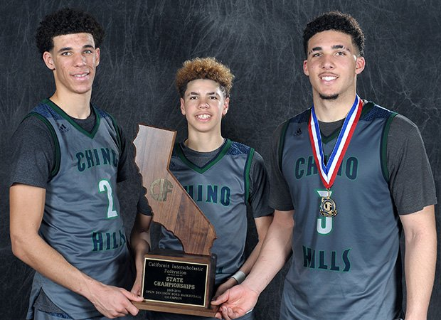 Lonzo, LaMelo and LiAngelo Ball – perhaps the best brother act in high school basketball history – pose with the state championship trophy after the game.