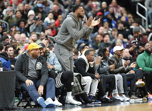 LeBron James cheers on his son's team during Saturday's game at Nationwide Arena.
