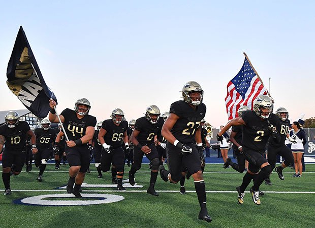 St. John Bosco takes the field in 2019.