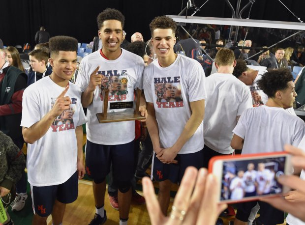 Michael Porter Jr. (right) with brothers Coban and Jontay after winning Washington's Class 3A state title in 2017.